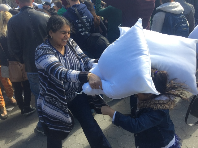 Being tourists in their own city - Mama & Daughter time at International Pillow Fight Day in NYC.