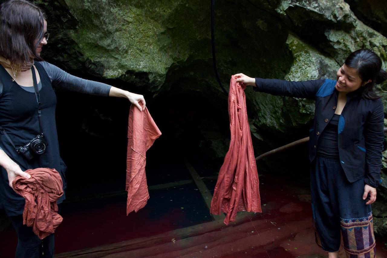 Vu Thao & Michela DuPasquier, a VAWAA client, rinsing fabric after magenta dyed